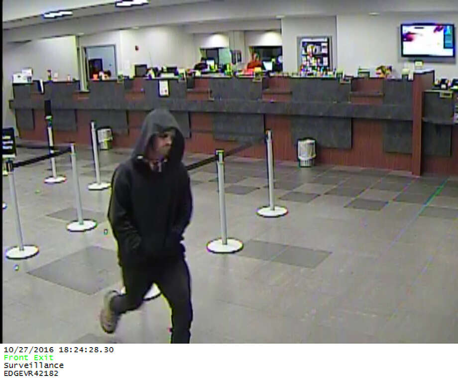 The robber is described as a thin white man in his mid-30s, 5?4?, with dark makeup circling his eyes. He was wearing a dark hooded jacket and dark jeans.