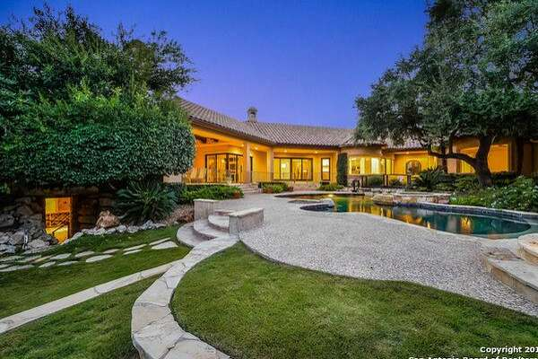 "San Antonio Spurs star Manu Ginobili listed his home in The Dominion with amenities like a wine cellar and private outdoor ""oasis"" for $2 million this week."