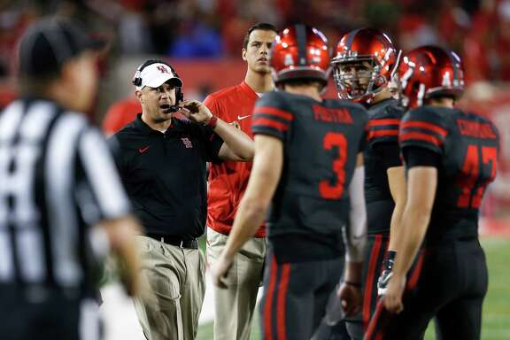 Houston head coach Tom Herman works with his offense during the first half of an NCAA football game against Connecticut at TDECU Stadium on Thursday, Sept. 29, 2016, in Houston. ( Brett Coomer / Houston Chronicle )