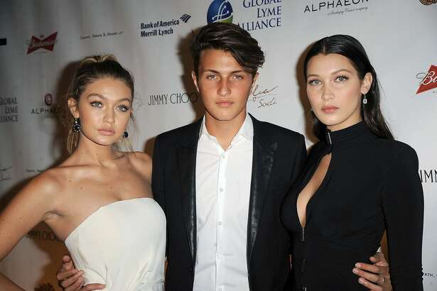 NEW YORK, NY - OCTOBER 08:  (L-R) Gigi Hadid, Anwar Hadid and Bella Hadid attend 2015 Global Lyme Alliance Gala at Cipriani 42nd Street on October 8, 2015 in New York City.  (Photo by Chance Yeh/WireImage)