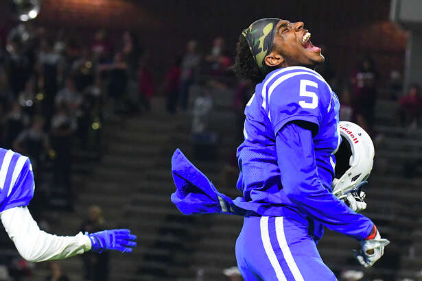 Cy Creek junior wide receiver Miles Battle celebrates after the 24-23 win against Cy Woods Thursday at Pridgeon Stadium. The game was not decided until Cy Woods missed a potentially game-winning 39-yard field goal with eight seconds remaining.