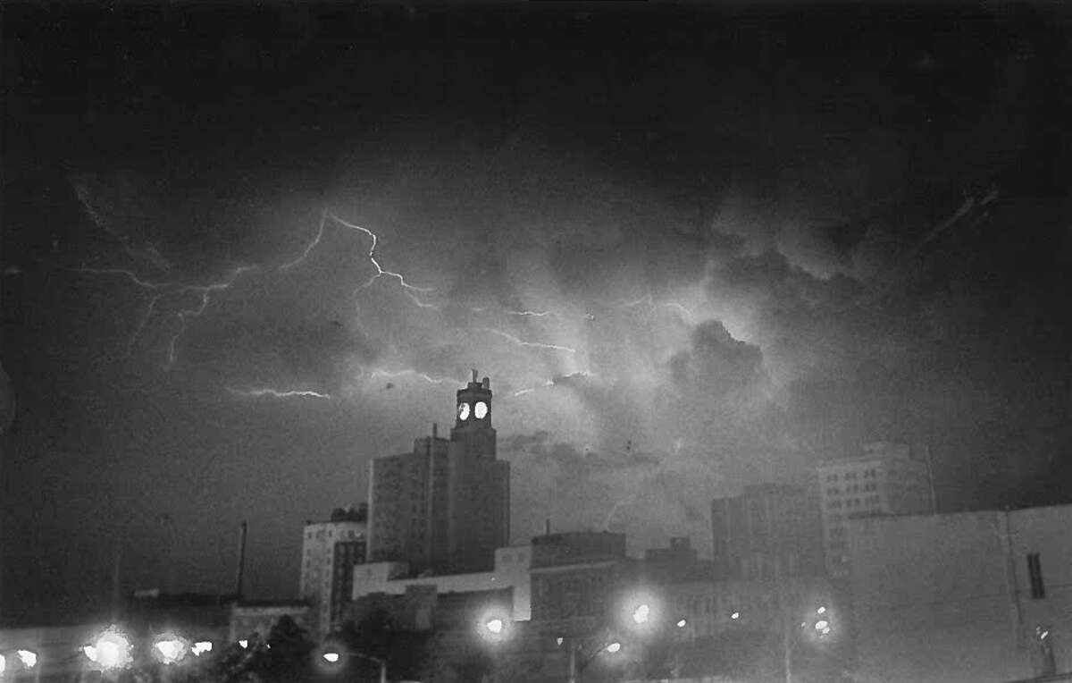 Downtown Beaumont in the 90s during a thunderstorm.