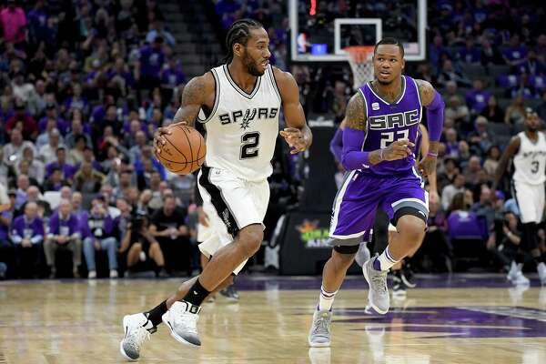 Kawhi Leonard of the Spurs steals the ball and breaks away from Ben McLemore of the Kings during the third quarter at Golden 1 Center on Oct. 27, 2016 in Sacramento, Calif.