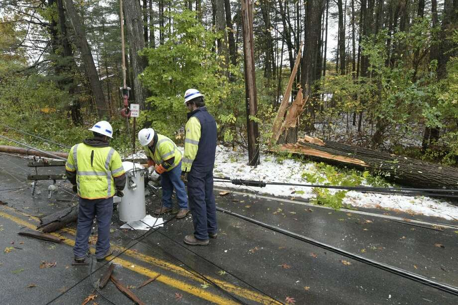 A National Grid crew repairs a damaged transformer on Glen Lake Road on Friday, Oct. 28, 2016, after an early season storm in Queensbury, NY. (Skip Dickstein/Times Union)