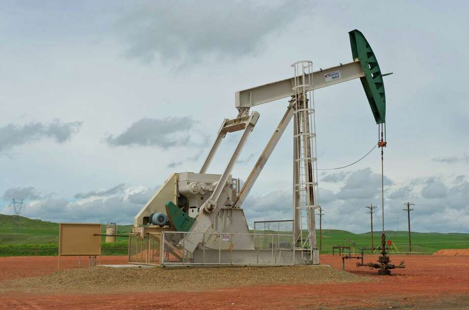 A pumpjack works on a ConocoPhillips project in the Bakken shale of North Dakota. ConocoPhillips announced Thursday that they are adding two drilling rigs to South Texas' Eagle Ford shale and three to the Bakken. Photo: /ConocoPhillips / © ConocoPhillips