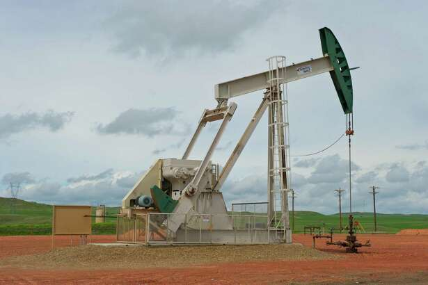 A pumpjack works on a ConocoPhillips project in the Bakken shale of North Dakota. ConocoPhillips announced Thursday that they are adding two drilling rigs to South Texas' Eagle Ford shale and three to the Bakken.