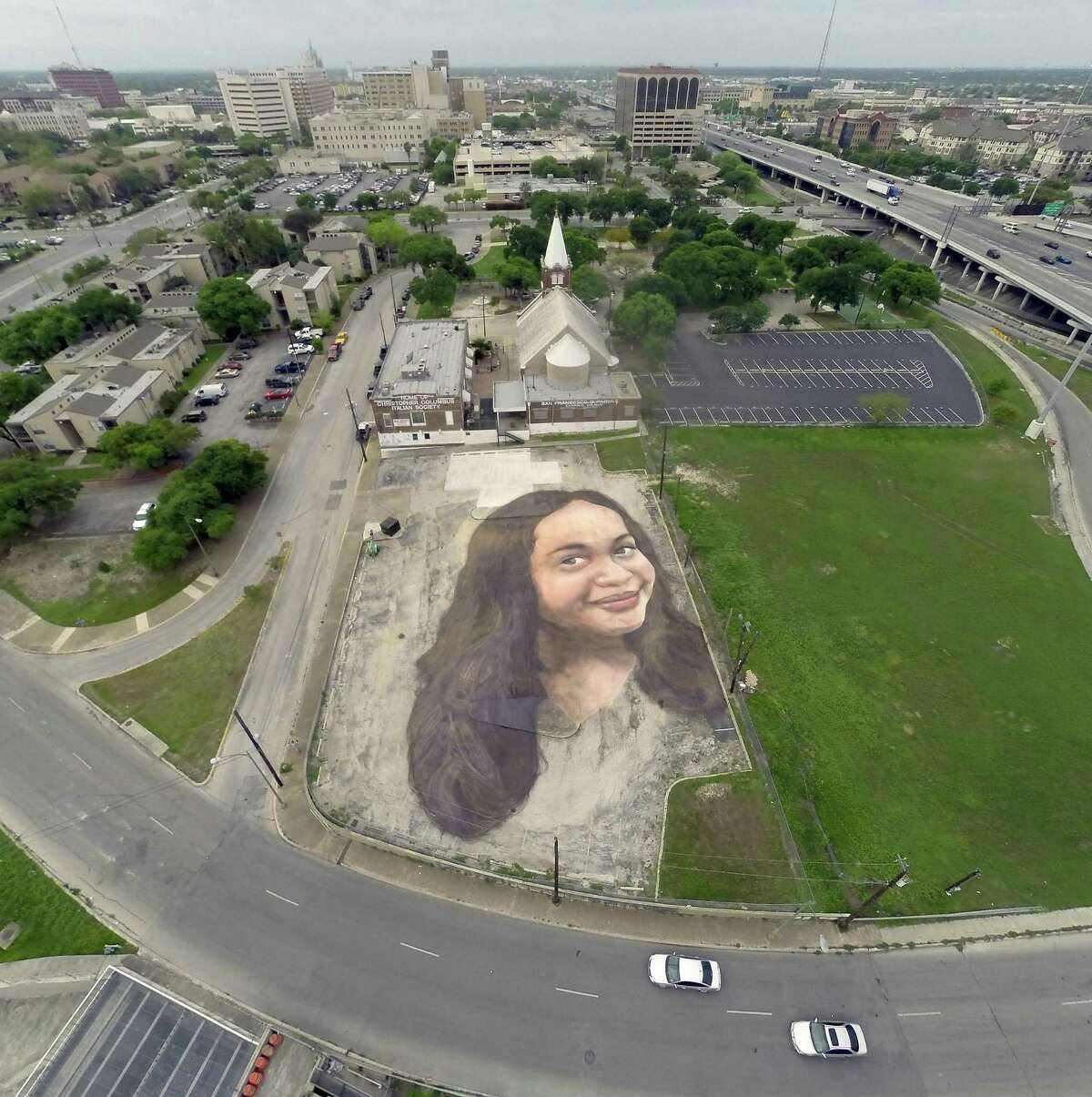 """""""Plethora"""" artist Jorge Rodriguez-Gerada previously painted this mural on the parking lot of the Christopher Columbus Italian-American Society in San Antonio in 2015."""
