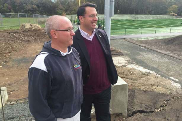 Milford Recreation Director Paul E. Piscitelli, left, and Mayor Benjamin Blake check out the progress of a pair of multi-sport fields that are taking shape on Orange Avenue. The fields will be ready for play in the spring.