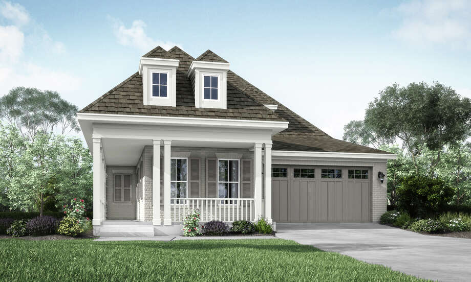 Gracepoint Homes in Woodforest's Kingsley neighborhood have front porches and painted brick.