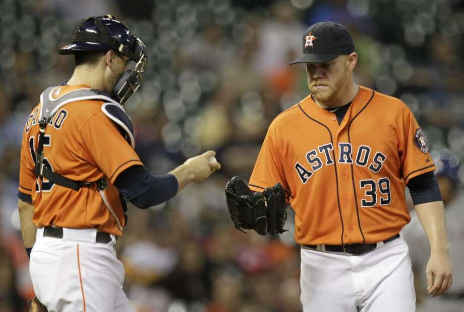 Houston Astros catcher Jason Castro hands ball to pitcher Brett Oberholtzer during third inning against the Texas Rangers at Minute Maid Park Friday, Aug. 29, 2014, in Houston. ( Melissa Phillip / Houston Chronicle ) Photo: Houston Chronicle