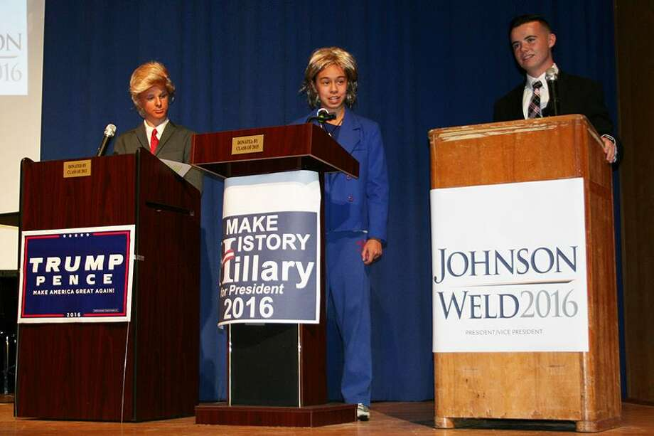 Students, from left, Connor Hall as Donald Trump, Julia Pugliese as Hillary Clinton and Andrew Fleck as Gary Johnson. in a debate on Thursday, Oct. 27, 2016, at Maple Hill High School in Castleton. (Schodack Central School District) Photo: Unknown