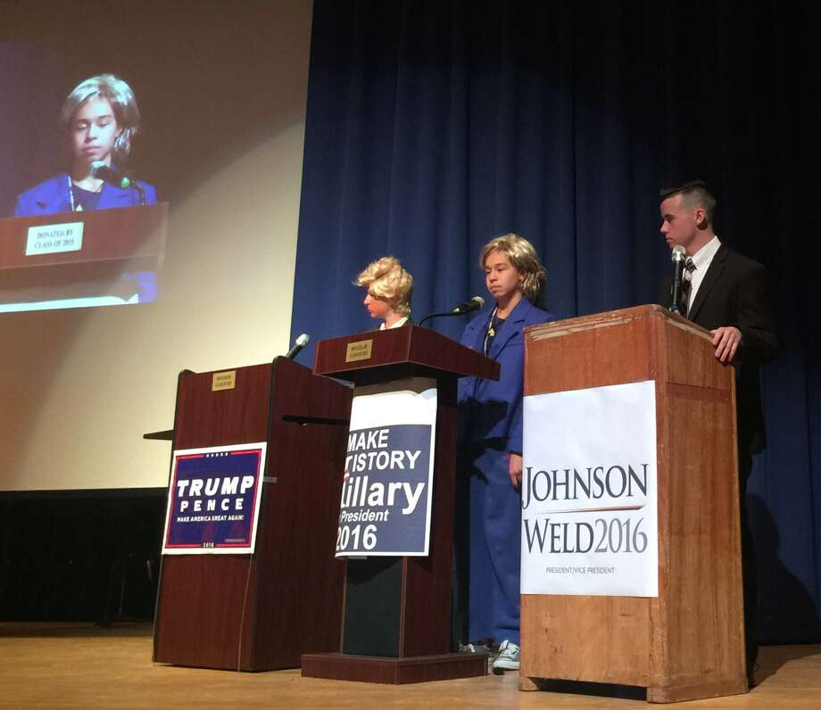 Students, from left, Connor Hall as Donald Trump, Julia Pugliese as Hillary Clinton and Andrew Fleck as Gary Johnson. in a debate on Thursday, Oct. 27, 2016, at Maple Hill High School in Castleton. (Dylan Rossiter/Special to the Times Union)