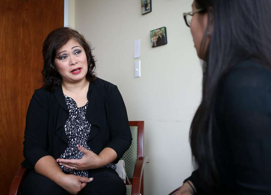 Homeowner Amy Macaraeg speaks with housing counselor Paula Canfil (right) at the National Asian American Coalition office in Daly City on Friday, Oct 28, 2016. Through the efforts of the NAAC, Macaraeg's loan was modified and interest rate lowered so she was able to keep her home of 23 years. Photo: Amy Osborne, Special To The Chronicle