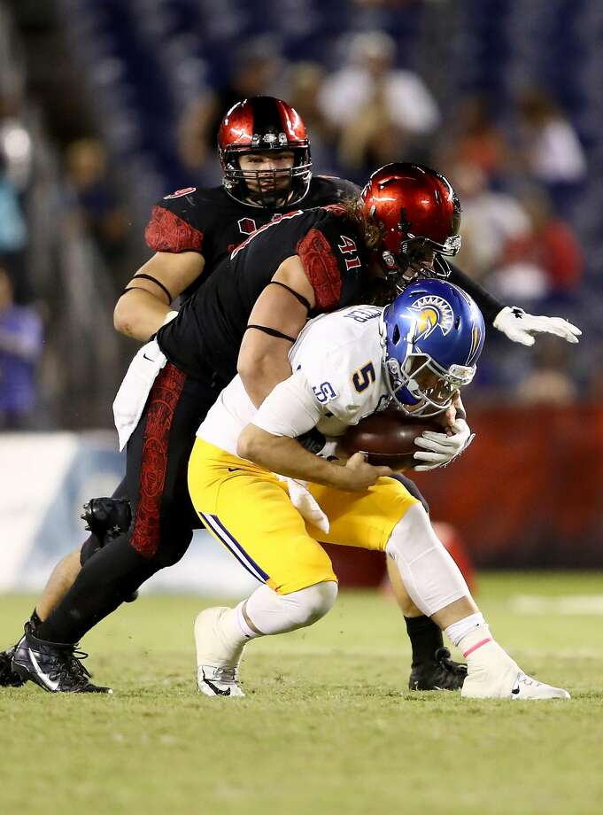 SAN DIEGO, CA - OCTOBER 21:  Dakota Turner #41 of the San Diego State Aztecs sacks Kenny Potter #5 of the San Jose State Spartans during the second half of a game  at Qualcomm Stadium on October 21, 2016 in San Diego, California.  (Photo by Sean M. Haffey/Getty Images) Photo: Sean M. Haffey, Getty Images