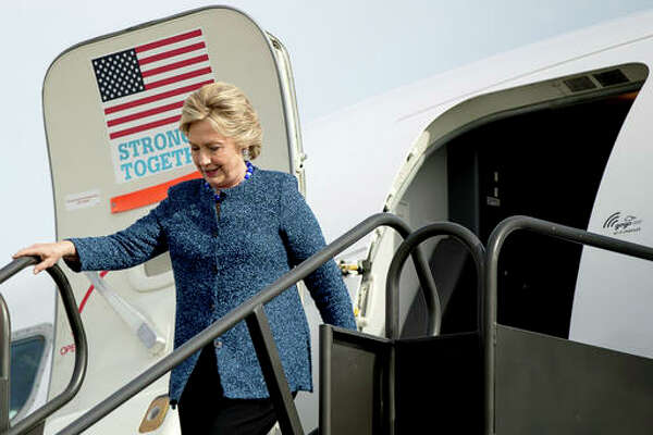Democratic presidential candidate Hillary Clinton arrives at Eastern Iowa Airport in Cedar Rapids, Iowa, on Friday, Oct. 28 to attend a rally.