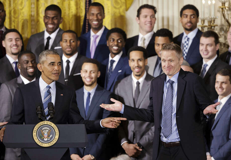 FILE - In this Feb. 4, 2016 file photo, President Barack Obama points to Golden State Warriors head basketball coach Steve Kerr during a ceremony in the East Room of the White House where the president honored the 2015 NBA Champions. Steve Kerr makes one thing perfectly clear: This special season is not about him. He doesn't want it that way, even if everybody comes back to his connections with the last NBA team to win so many games, those 1995-96 Bulls. Photo: Pablo Martinez Monsivais, AP