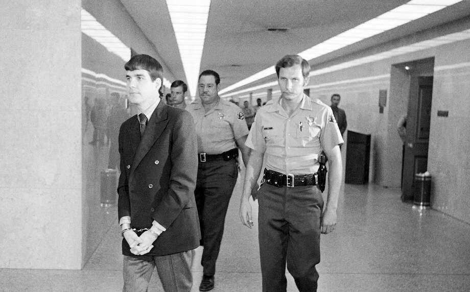 A 1971 photo shows Charles Watson (left) after his conviction in the Los Angeles slayings ordered by Charles Manson. Photo: George Brich, Associated Press