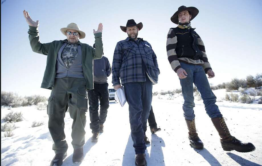 In this Jan 8, 2016, file photo, Burns resident Steve Atkins, left, talks with Ammon Bundy, center, one of the sons of Nevada rancher Cliven Bundy, following a news conference at Malheur National Wildlife Refuge near Burns, Ore. Photo: Rick Bowmer, Associated Press