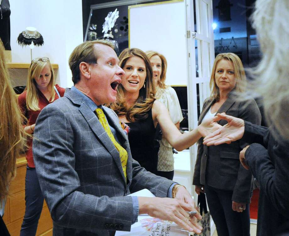 "Celebrity stylist Carson Kressley, left, reacts as his co-author Riann Smith, center, introduces him to Anne Fontaine during Kressley's book signing at the Anne Fontaine store located at 234 Greenwich Avenue, Greenwich, Conn., Wednesday night, Oct. 26, 2016. Kressley's new book, ""Does This Book Make My Butt Look Big?: A Cheeky Guide to Feeling Sexier in Your Own Skin & Unleashing Your Personal Style,""  is now available for purchase. Fontaine, the store's namesake, is the creative director of the Anne Fontaine women's luxury fashion brand. Photo: Bob Luckey Jr. / Hearst Connecticut Media / Greenwich Time"