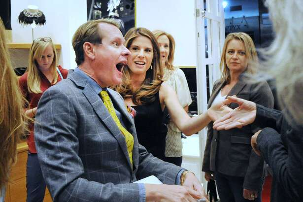 "Celebrity stylist Carson Kressley, left, reacts as his co-author Riann Smith, center, introduces him to Anne Fontaine during Kressley's book signing at the Anne Fontaine store located at 234 Greenwich Avenue, Greenwich, Conn., Wednesday night, Oct. 26, 2016. Kressley's new book, ""Does This Book Make My Butt Look Big?: A Cheeky Guide to Feeling Sexier in Your Own Skin & Unleashing Your Personal Style,""  is now available for purchase. Fontaine, the store's namesake, is the creative director of the Anne Fontaine women's luxury fashion brand."