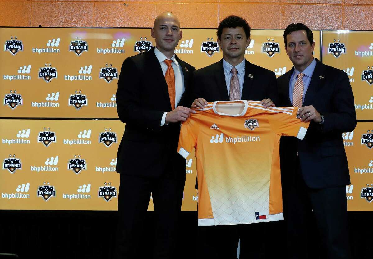 Matt Jordan, Vice President/General Manager of the Houston Dynamo with Wilmer Cabrera, center, introduced as the new head coach and Chris Canetti President, hold up a jersey during the press conference at BBVA Compass Friday,Oct. 28, 2016 in Houston.