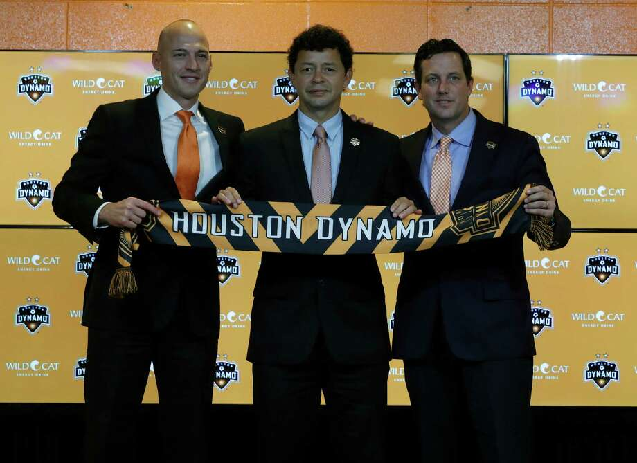 Matt Jordan, Vice President/General Manager of the Houston Dynamo with Wilmer Cabrera, center, introduced as the new head coach and Chris Canetti President, hold up a scarf during the press conference at BBVA Compass Friday,Oct. 28, 2016 in Houston. Photo: Karen Warren, Houston Chronicle / 2016 Houston Chronicle