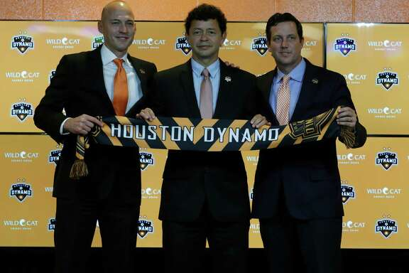 Matt Jordan, Vice President/General Manager of the Houston Dynamo with Wilmer Cabrera, center, introduced as the new head coach and Chris Canetti President, hold up a scarf during the press conference at BBVA Compass Friday,Oct. 28, 2016 in Houston.