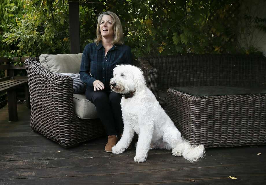Corinne Cole, who uses the iHear devices, sits with her dog Calvin at her home in Moraga. She has worn hearing aids for more than 20 years. Photo: Michael Macor, The Chronicle