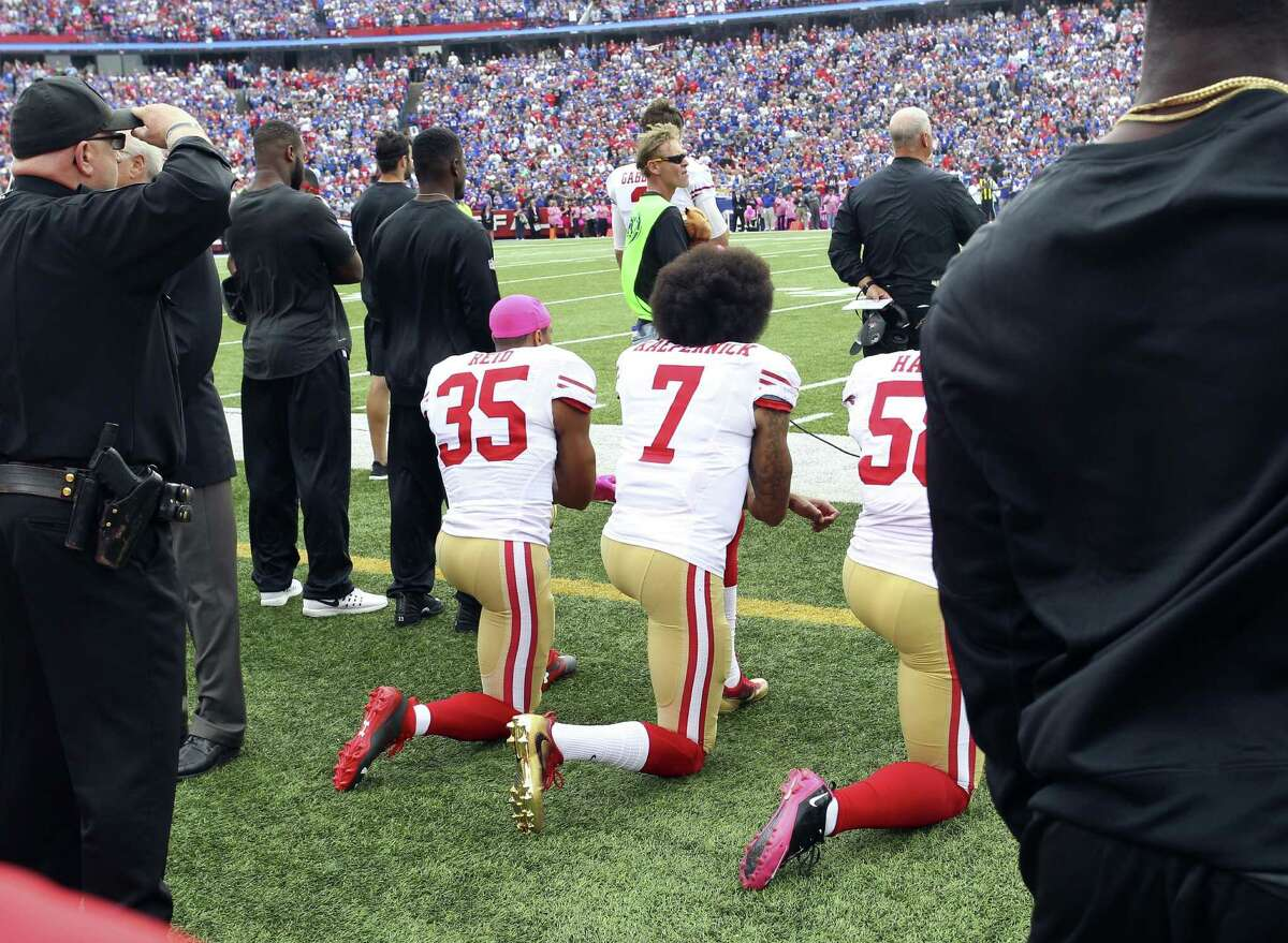 San Francisco 49ers free safety Eric Reid (from left), quarterback Colin Kaepernick and outside linebacker Eli Harold kneel during the national anthem on Oct. 16. Sports , can help start, or restart, t very important conversations.