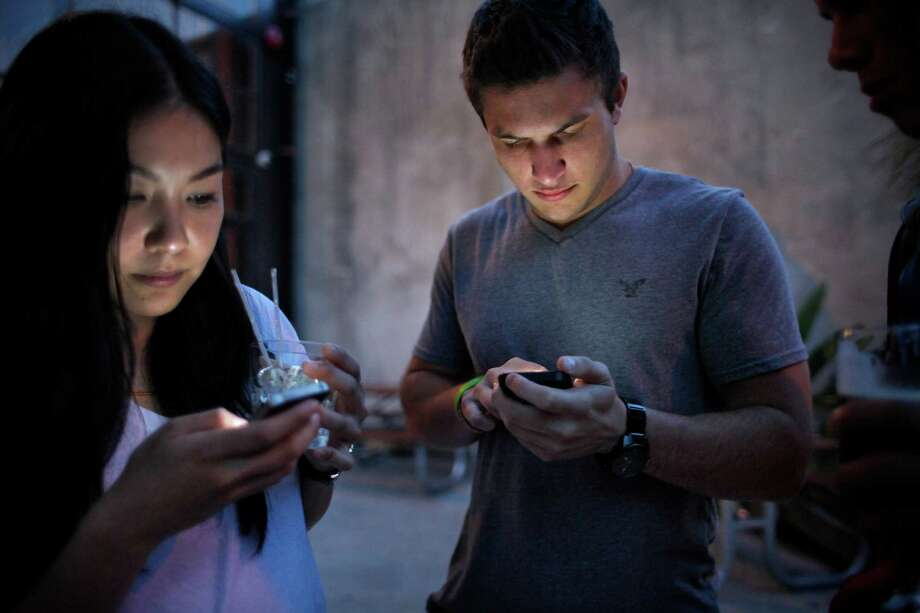 Robby Ayala, right, of San Francisco once claimed he had 2.6 million followers on Vine. But the six-second video app owned by Twitter is shutting down.  Photo: PRESTON GANNAWAY, STR / NYTNS