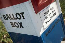A ballot box is seen outside the San Mateo County Election's Office, Friday, Nov. 6, 2015, in San Mateo, Calif. An all-mail election was held in San Mateo County. Officials are expecting a higher voter turnout and believe an all-mail election is more convenient to voters.
