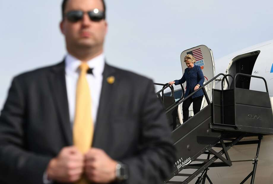Democratic candidate Hillary Clinton leaves her campaign plane in Cedar Rapids, Iowa, the day her email problems returned. Photo: JEWEL SAMAD, AFP/Getty Images