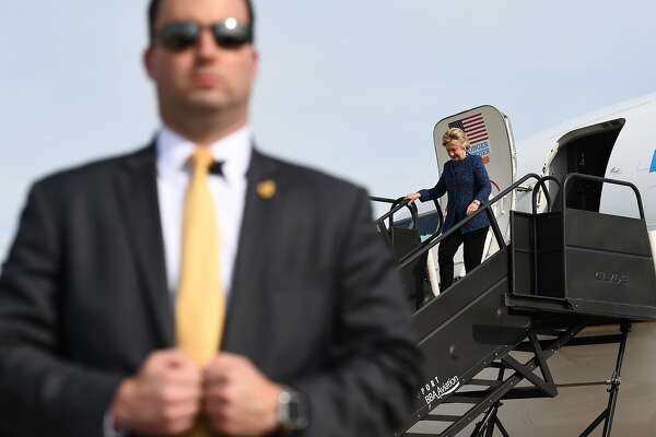 US Democratic presidential nominee Hillary Clinton waves as she walks off her campaign plane in Cedar Rapids, Iowa, on October 28, 2016.   / AFP PHOTO / Jewel SAMADJEWEL SAMAD/AFP/Getty Images