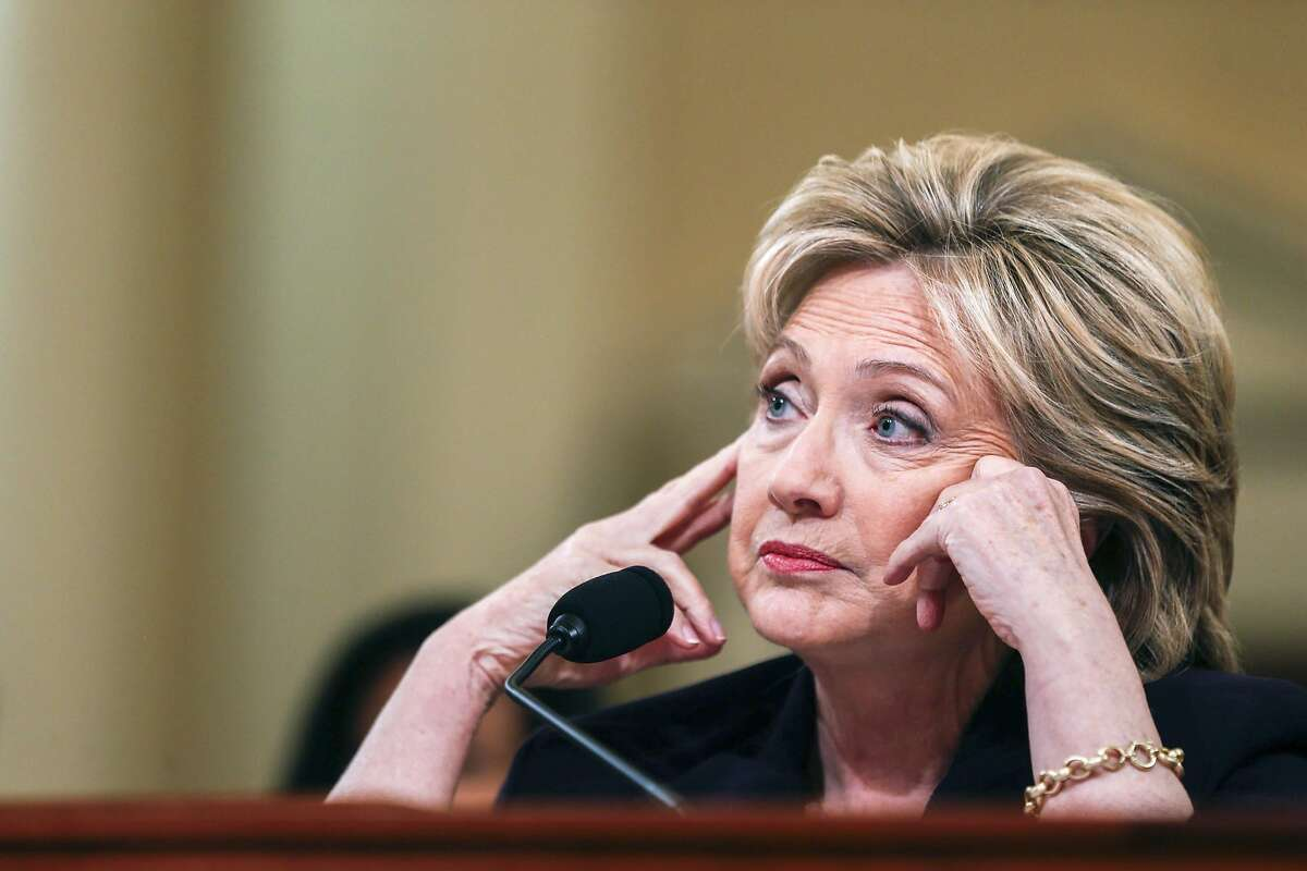 FILE � Former Secretary of State Hillary Clinton testifies before the House Select Committee on Benghazi, on Capitol Hill in Washington, Oct. 22, 2015. Newly-uncovered emails �appear to be pertinent� to the closed investigation into whether Clinton or her aides mishandled classified information, the FBI disclosed on Oct. 28, 2016. (Zach Gibson/The New York Times)