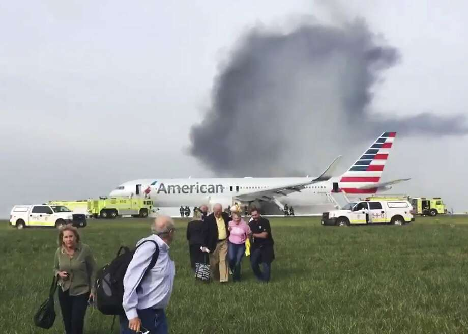 Passenger Jose Castillo provided this photo showing fellow passengers exiting a burning jet that caught fire at Chicago's O'Hare International Airport. Photo: Jose Castillo, Associated Press