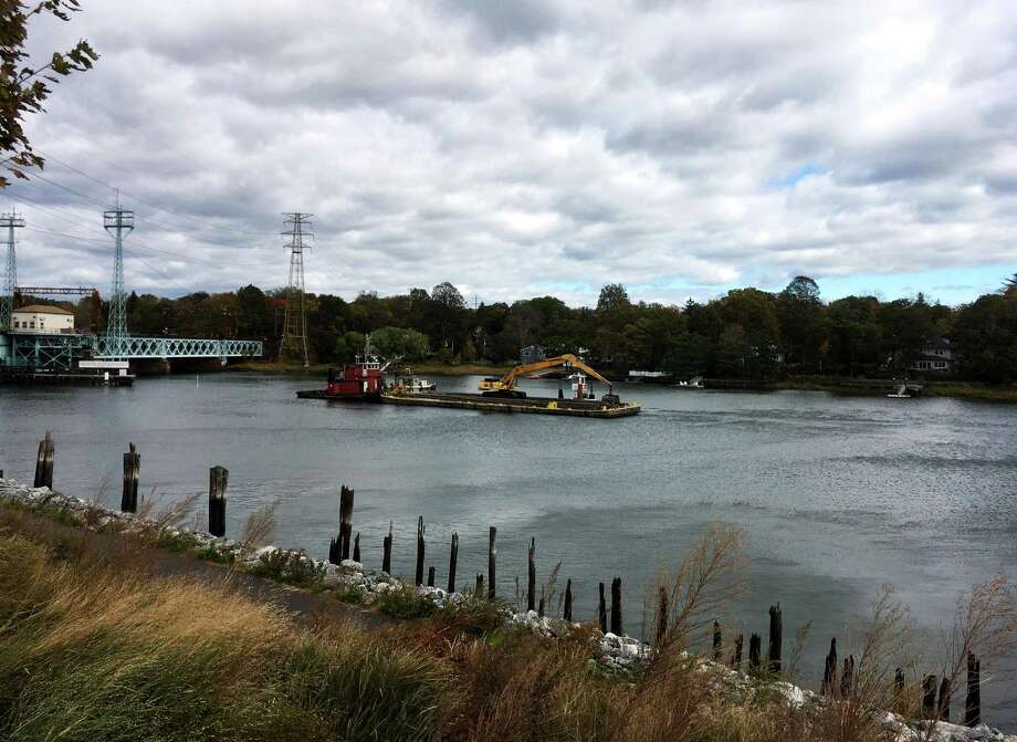 The Mianus River dredging project has started and was an active scene on Friday, Oct. 28, 2016 in Greenwich, Conn. About 50,000 cubic yards of silt is expected to be removed from the channel of the river in Cos Cob Harbor by Christmas. Photo: Peregrine Frissell / Hearst Connecticut Media / Greenwich Time