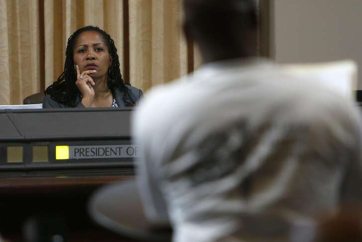 Councilmember Lynette Gibson McElhaney listens to Al Marshall speak during Oakland City Council meeting in Oakland, Calif., on Monday, June 22, 2015.