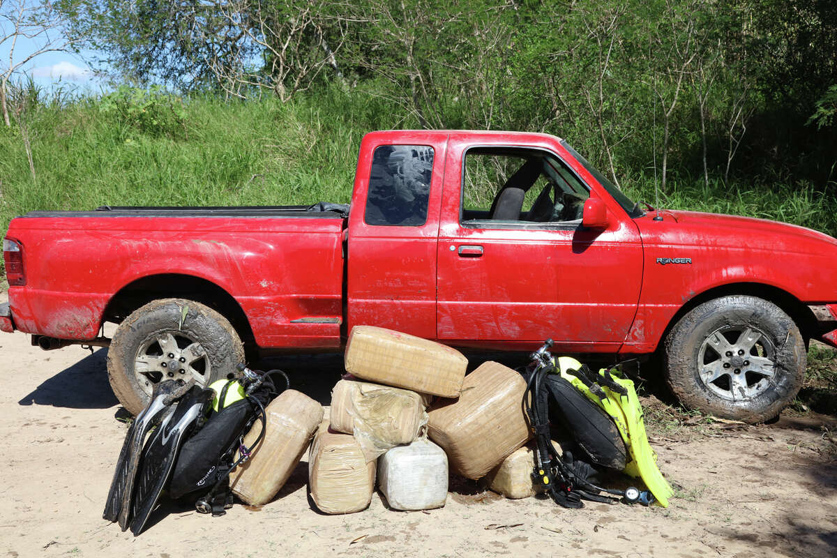 U.S. Border Patrol agents recover a truck from the Rio Grande they say was used in an attempt to smuggle drugs into the U.S. on Wednesday, Oct. 26, 2016.