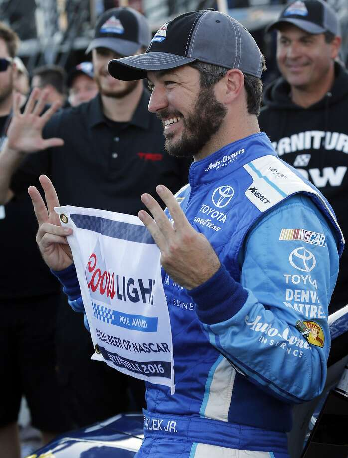 Driver Martin Truex Jr. will lead the pack into Turn 1 at Sunday's NASCAR Sprint Cup race. Photo: Steve Helber, Associated Press