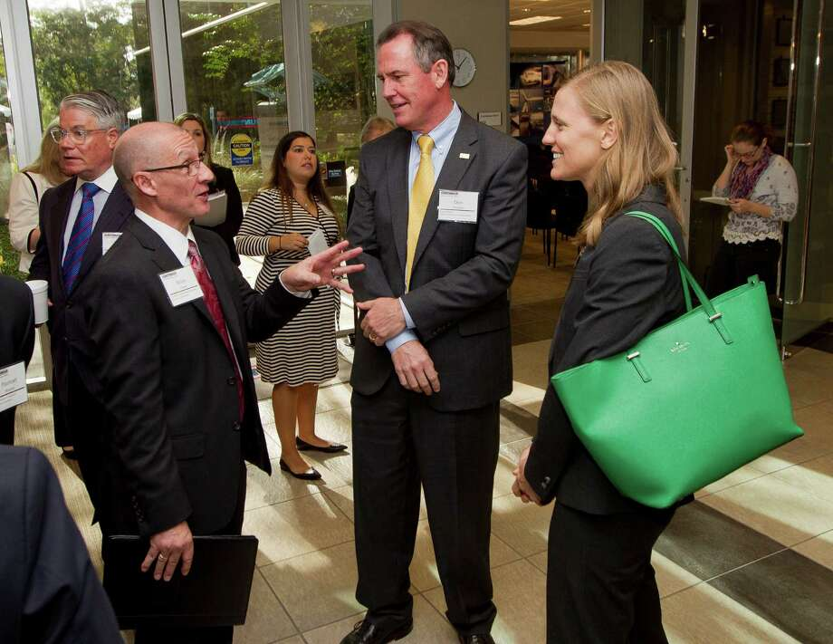 Brian Pellon, vice president of R&D and The Woodlands Operations at Huntsman Corporation, left, speaks with Conroe ISD Superintendent Don Stockton and Monica Bompkamp-Enia, president of Education for Tomorrow Alliance, before a tour of the company's operation in The Woodlands Tuesday, Oct. 25, 2016. Photo: Jason Fochtman, Staff Photographer / Houston Chronicle