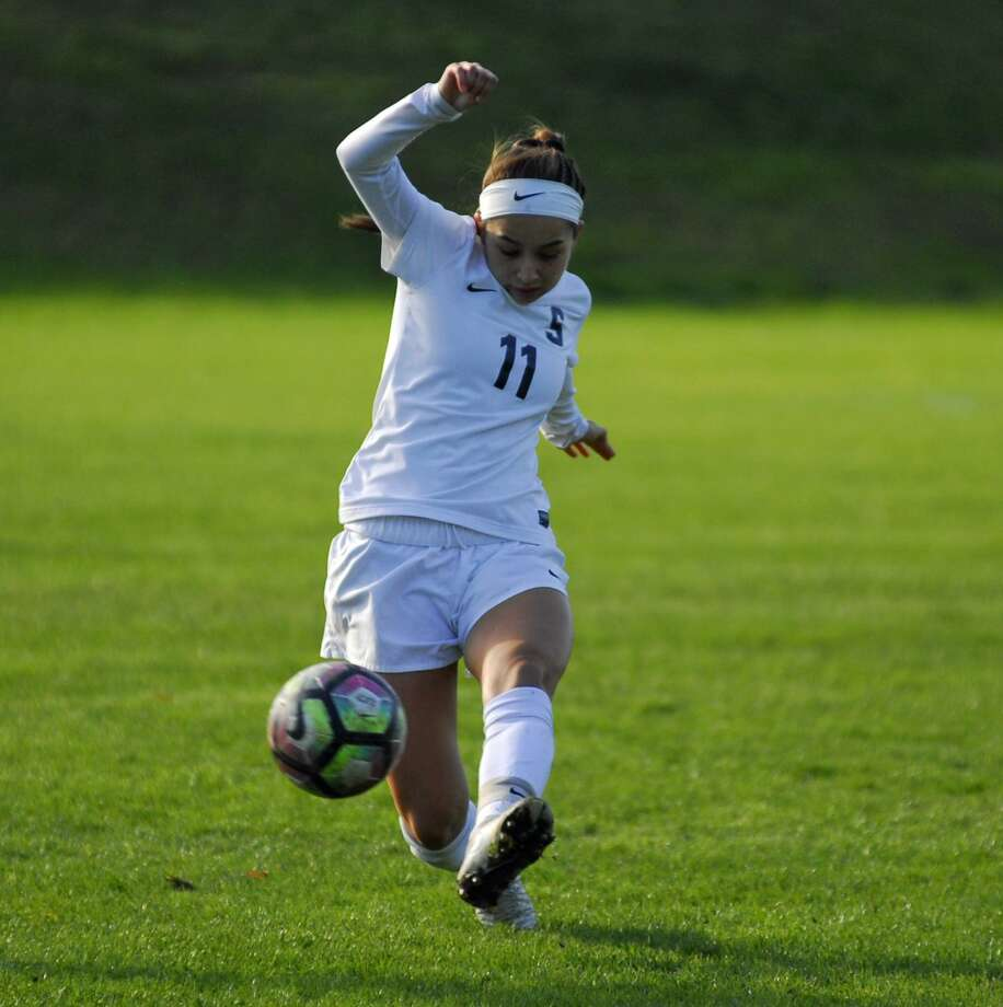 Staples' Tia Zajec plays the ball upfield during a 4-1 win over Darien on Friday. Photo: Ryan Lacey / Hearst Connecticut Media