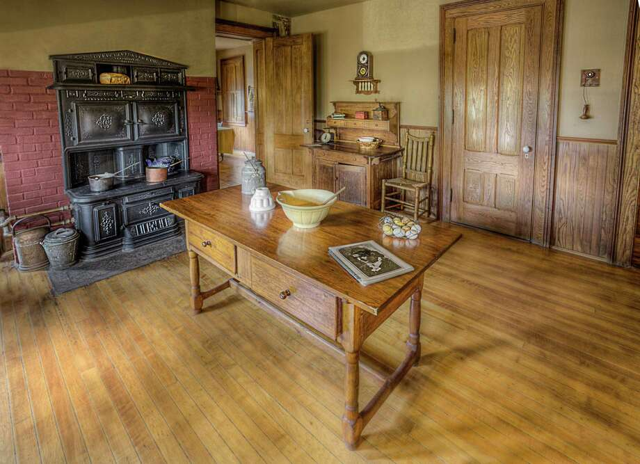 Mark Twain's kitchen is seen as it appeared when he lived with his family in Hartford. Notice the telephone hanging from the wall. He was among the first people to have a phone in his home, and often complained about the poor service. Photo: Lisa Cuchara / Contributed Photo / Lisa Cuchara