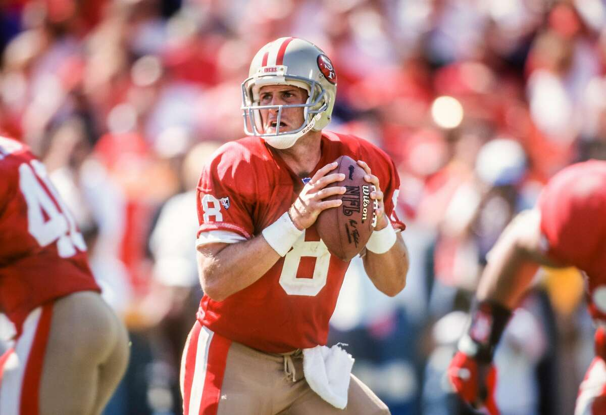 Steve Young of the San Francisco 49ers looks to throw a pass during a National Football League game against the New England Patriots played on Sept. 17, 1995, at Candlestick Park in San Francisco.