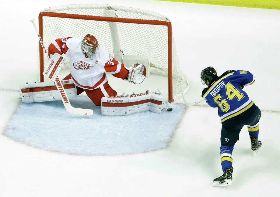 Detroit Red Wings goalie Petr Mrazek, of the Czech Republic, makes a save on a shot by St. Louis Blues' Nail Yakupov, of Russia, (64) during the first period of an NHL hockey game Thursday, Oct. 27, 2016, in St. Louis. (AP Photo/Jeff Roberson) Photo: Jeff Roberson, STF / Copyright 2016 The Associated Press. All rights reserved.