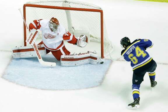 Detroit Red Wings goalie Petr Mrazek, of the Czech Republic, makes a save on a shot by St. Louis Blues' Nail Yakupov, of Russia, (64) during the first period of an NHL hockey game Thursday, Oct. 27, 2016, in St. Louis. (AP Photo/Jeff Roberson)