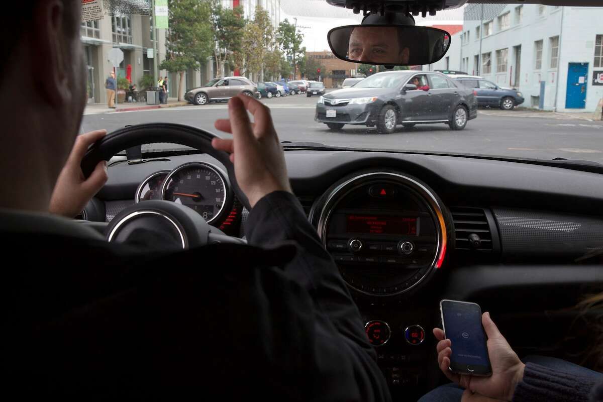 Vlad Sirobsky uses the EDriving Mentor app during a beta test run near Jack London Square on Friday, Oct. 28, 2016 in Oakland, Calif. The app uses the phone's GPS and gyroscope to collect driver data on speeding, hard stops, fast acceleration and cell phone usage while driving. FICO will then turn the info into a score that can be used to monitor the driving habits of teens and employees. Eventually the data could be used to price insurance.