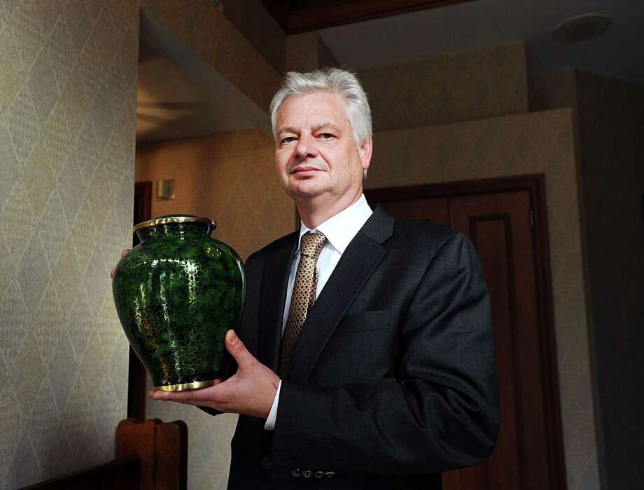 Funeral Director Matthew Murphy with an urn that is available to hold the ashes of the deceased at the Fred Knapp Funeral Home in Greenwich on Friday. With an increase in the popularity of cremations, the Vatican has issued new guidelines for Roman Catholics barring the scattering of ashes in nature and is now urging that the cremated remains be preserved in approved sacred places or cemeteries. Photo: Bob Luckey Jr. / Hearst Connecticut Media / Greenwich Time