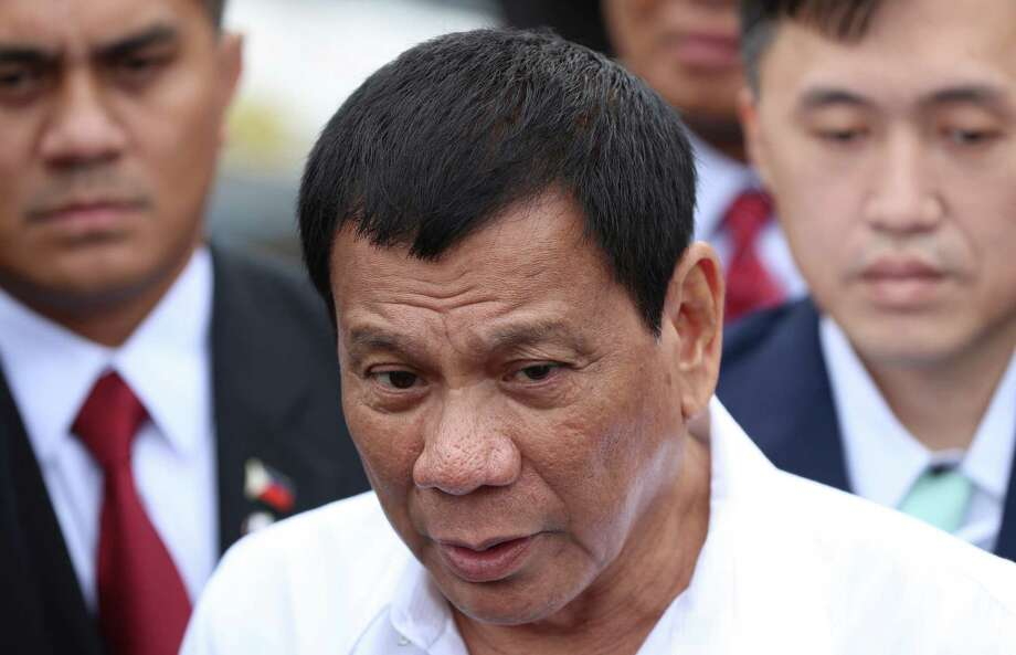Philippine President Rodrigo Duterte speaks to journalists after a coast guard training demonstration at a Japan Coast Guard base in Yokohama, Thursday, Oct. 27, 2016. Duterte is on a three-day official visit to Japan, his first as Philippine leader. (AP Photo/Eugene Hoshiko) Photo: Eugene Hoshiko, STF / Copyright 2016 The Associated Press. All rights reserved.