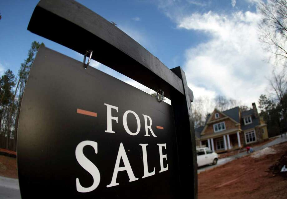 FILE - In this Thursday, Dec. 3, 2015, file photo, a home under construction and for sale is shown in Roswell, Ga. On Wednesday, Oct. 26, 2016, the Commerce Department reports on sales of new homes in September. (AP Photo/John Bazemore, File) Photo: John Bazemore, STF / Copyright 2016 The Associated Press. All rights reserved. This material may not be published, broadcast, rewritten or redistribu