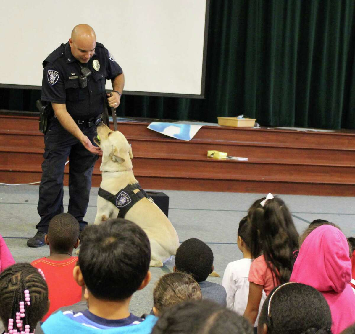 Spring ISD Police Officer Fuentes and K-9 Paco demonstrate the narcotic detector dogÂ?'s skills during a Red Ribbon Week assembly at Major Elementary School.